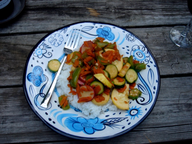 A typical no-meat meal: stir fried squash, carrots, bell pepper, zucchini, carrots, and okra with garlic, red pepper, thai basil, lime juice, and soy sauce.