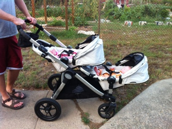 Baby Jogger with the seats facing backward and fully reclined.