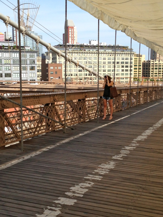 Jessica taking pics on the Brooklyn Bridge.
