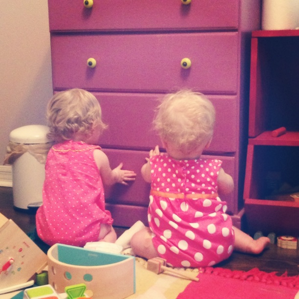 Teamwork: working together to open the drawer and remove all the diapers inside. Sibling love!