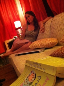 A picture of me from the very start of my pregnancy, guzzling water, a pregnancy book beside me.