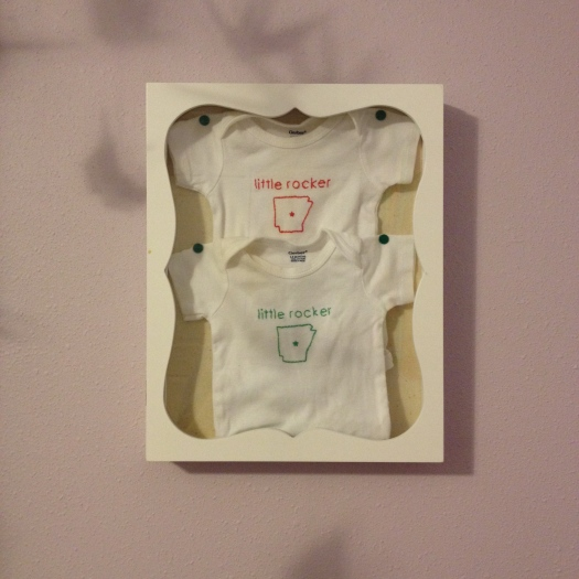 The girls wore these onesies in their newborn photos, so I made them into keepsake wall art now that they've grown.