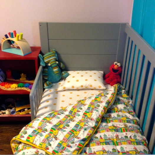 The cribs are Baby Mod from Wal Mart. The Small World-esque bedding is from Land of Nod.