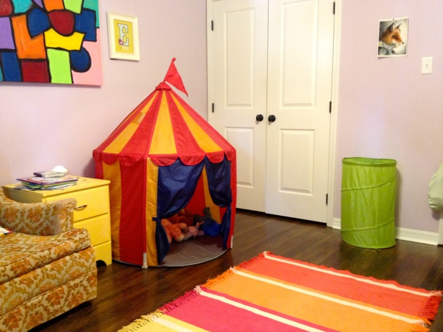 The Ikea circus tent makes a great storage zone for stuffed animals. Their dresser is actually inside the closet-- less chance of kiddos pulling everything out of drawers that way.