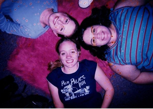 For fun, here's a picture of me in freshman year of college, with my friends, posing on my roommate's hot pink faux fur rug.
