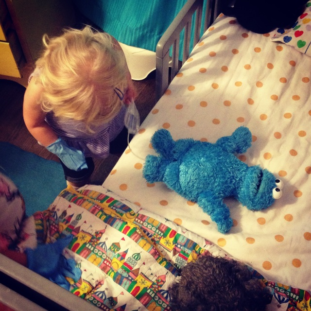 Using catheters: part of life for most people with SB. Claire's helping Cookie Monster out with his cath.
