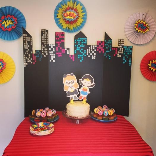 Superhero Girls' Fourth Birthday Party Cake Table Setup